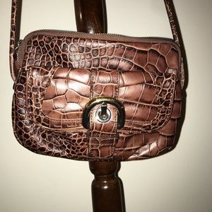 B. Mykowski leather crossbody bag